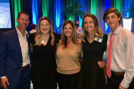 Adam Goldstein with his family and UCF nursing alumna Haley, RN