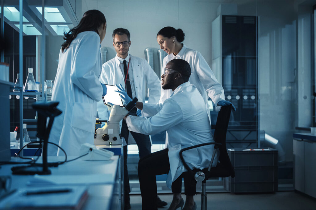 Photo of scientists and researchers working together in a lab.